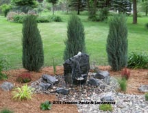 Boulder fountain and landscape installation in Lake Elmo, MN.