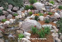 closeup photo of pondless waterfall & landscape installation in Bloomington MN