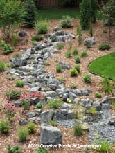 Pondless waterfall installation in Woodbury MN. Click photo to enter gallery