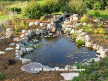 photo of pond & waterfall installation in St. Cloud MN.Click to enter gallery