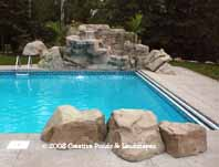 photo of swimming pool waterfall constructed using artificial rock