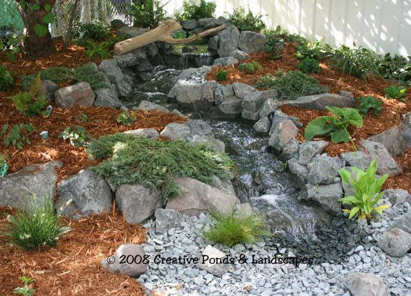 Photo of pondless waterfall & landscaping installation in St. Paul MN.