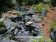 Photo of pond/waterfall & landscape installation in Dellwood MN.