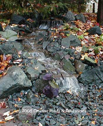 Pondless waterfall created with the Aquascape Designs Inc Pondless waterfall system