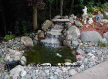 """before"" photo of pond & waterfall in Maple Grove MN."