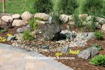 """after"" photo of boulder fountain & landscape installation in St. Paul, Minneapolis MN."