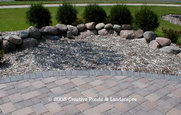 Before photo of boulder fountain project in Roseville, MN.