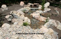 Photo: pondless waterfall before landscape installation.