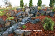 Photo of pondless waterfall & landscape installation in Woodbury MN